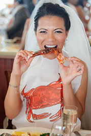 bride eating lobster at lobster clambake reception