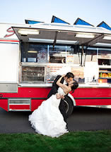 bride and groom kissing in front of the ChowderMobile